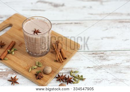 Masala Chai Made By Brewing Black Tea With Aromatic Spices And Herbs, Such As Cinnamon Stick, Thai C