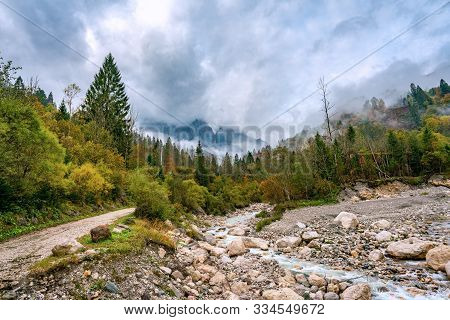 Panoramic View Of The River Torrente Mis Near California (gosaldo) In Italy With Low Water In Autumn