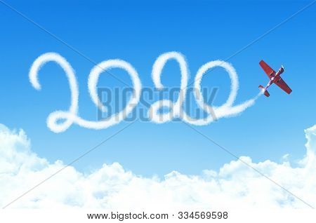 Happy New Year 2020 Concept On The Background Below Cloudscape. Drawing By Passenger Airplane White