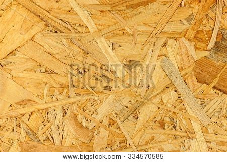 Building Material. Osb Boards Are Made Of Brown Wood Chips Sanded Into A Wooden Background. Backgrou