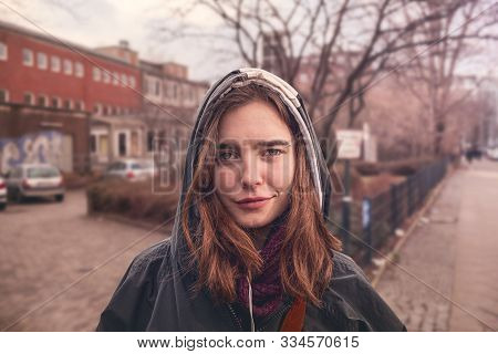 Portrait Of A Young Woman With Hoodie In The Streets Of Berlin