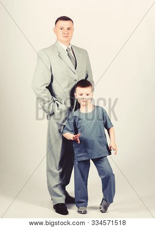Respectable Profession. Man Respectable Businessman And Little Kid Doctor Uniform. Family Business.