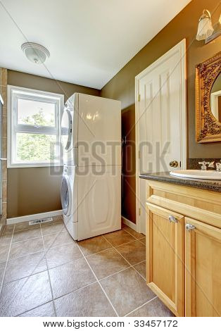 Laundry Room With Bathroom Cabinet And Sink.
