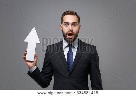 Shocked Young Bearded Business Man In Classic Black Suit Shirt Tie Posing Isolated On Grey Backgroun