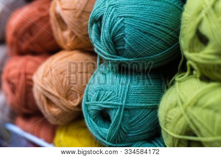 Colored Skeins Of Wool On The Shelf Of The Shop For Needlework. Selection Of Colorful Yarn Wool On S