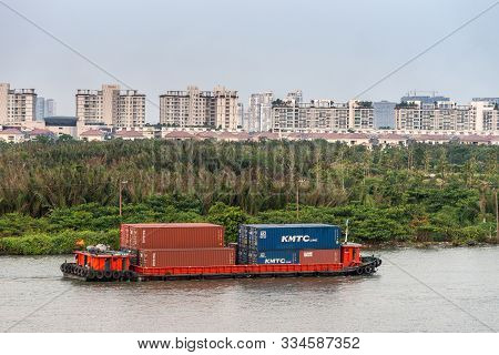 Ho Chi Minh City, Vietnam - March 12, 2019: Closekup Of Small Red Container Barge On Song Sai Gon Ri
