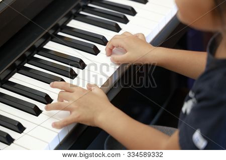Japanese Girl Playing A Piano (4 Years Old)