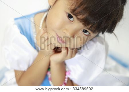 Japanese Girl In A Dress Resting Chin In Her Hands (4 Years Old)
