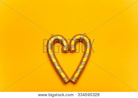 Golden Heart-shaped Christmas Decorations On A Yellow Background. Festive Mood, Luxury Party, Winter