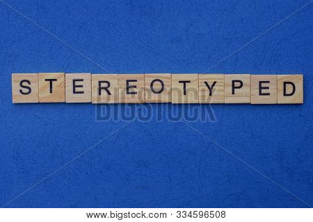 Word Stereotyped Made From Brown Wooden Letters Lies On A Blue Table