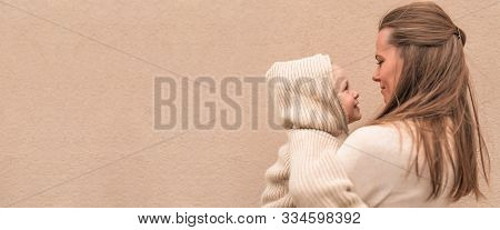 Happy Young Family, Woman Mother Holds Little Boy Smiling Couple Having Fun, Warm Autumn Clothes Wit