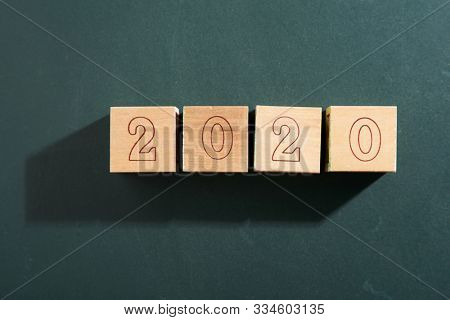 wooden block with number 2020 happy new year
