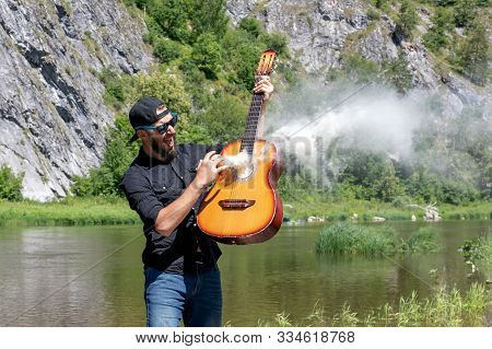 Photo Of Screaming Stubble Cheerful Handsome Attractive Musician Against Backdrop Of Bright Summer L