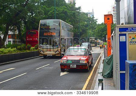Hong Kong, China - Nov 10, 2015: Hong Kong Urban Red Toyota Crown Comfort Yxs10 Four Seats Taxi On N
