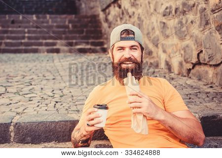 What A Snack. Bearded Man Eating Unhealthy Hot Dog Sandwich Snack. Hipster Resting And Having Hotdog
