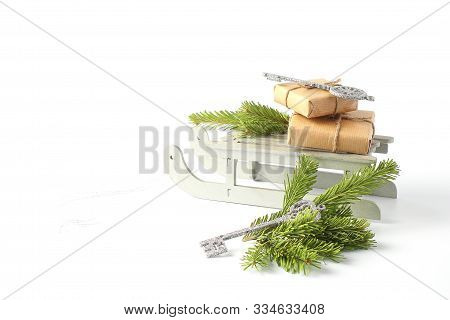 Christmas Sleigh With Gifts. New Years Concept. Decorative Toys In The Form Of Silver Key And Green