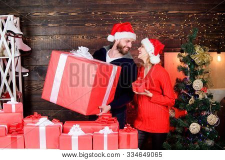 Gift From Santa Claus. Man And Woman With Gift Boxes. Guy With Big Gift Box. Family Shopping. Surpri