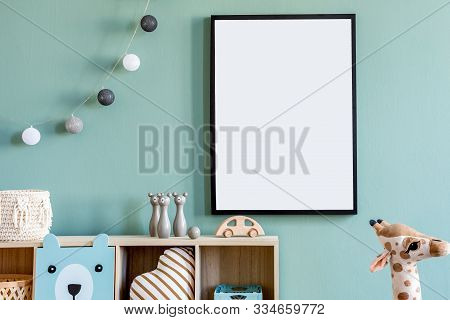 Stylish Scandinavian Newborn Baby Room With Wooden Cabinet, Toys, Mock Up Poster Frame And Children