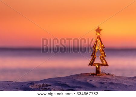 A Coastal Summer Christmas In Australia.  A Driftwood Christmas Tree Decorated With Fairy Lights On