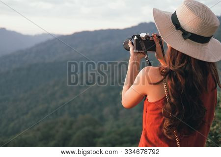 Woman Take Photo. Traveler Tourist Travel On Holiday Vacation. Journey Trip Concept