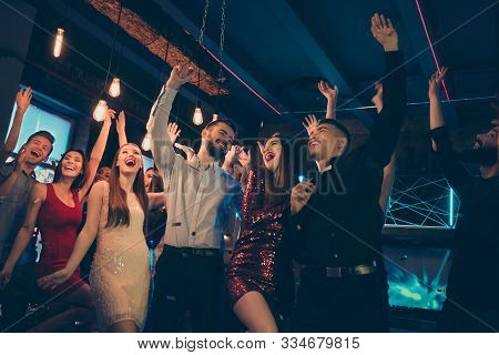 Low Below Angle View Photo Of Crazy Ecstatic Excited Cheerful People Dressed In Formalwear Rejoicing