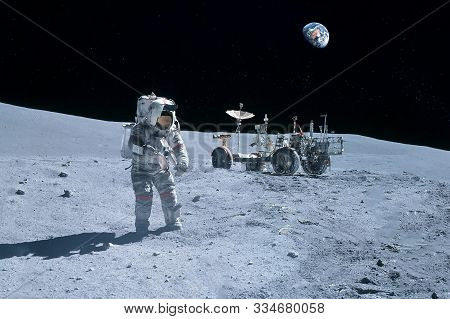 Astronaut Near The Moon Rover On The Moon. With Land On The Horizon. Elements Of This Image Were Fur