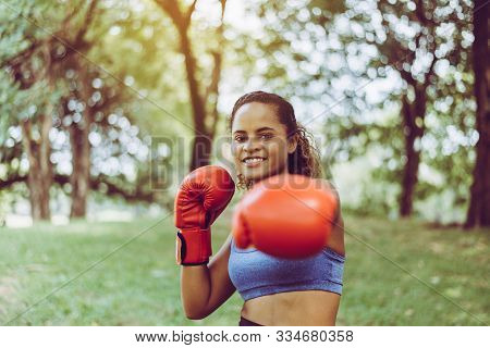 Sporty Black Woman Boxer Punching At Park,female Boxer Eye Looking Training To You