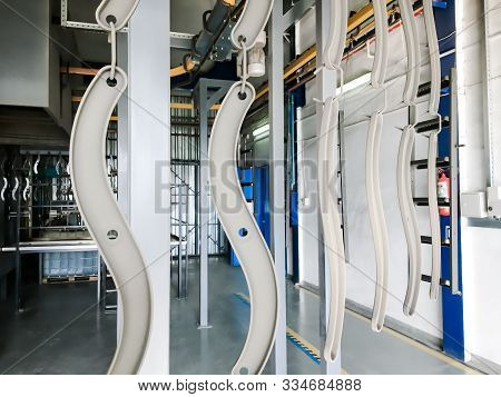Powder Coating Line. Metal Panels Are Suspended On An Overhead Conveyor Line. Painting Products In A