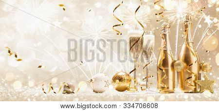 New Years Eve Celebration Background with Champagne and Confetti. Golden Holiday Party