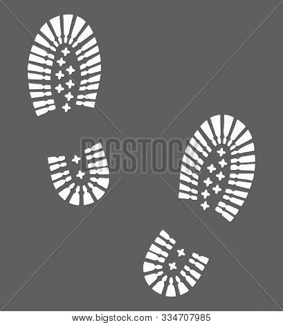 Hiking boots footprints graphic icon. Footprints shoe sign isolated on gray background. Vector illustration