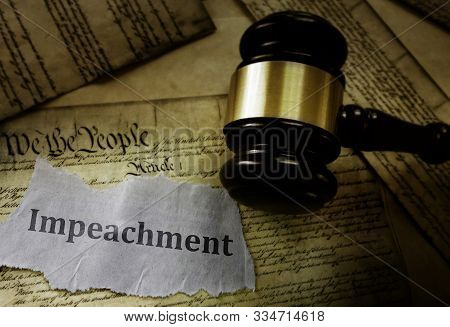 Impeachment Message On Pages Of The Us Constitution With Legal Gavel