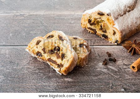 German Stollen, Christstollen, With Marzipan On Dark Brown Rustic, Weathered Wood Panel Background W