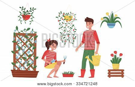 Floristry Concept. Flower Arrangers Taking Care Of Plants And Flowers