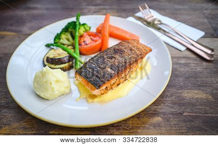Pan Seared Crispy Skin Salmon Fillet With Hollandaise Sauce, Baked Vegetables And Mashed Potato On W