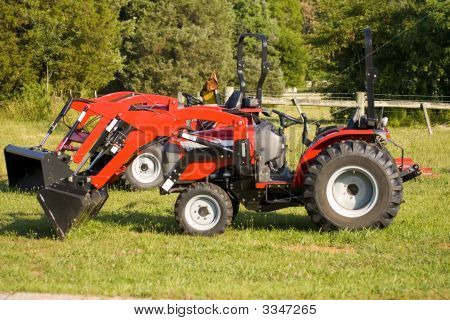 Two Small Red Tractors