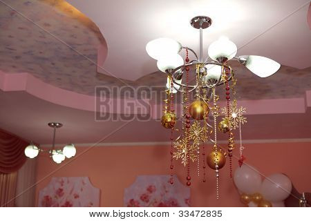 chandelier with christmas bulbs