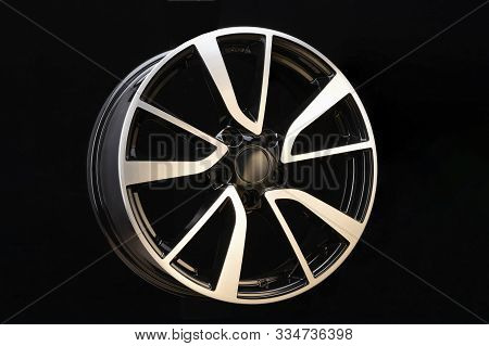 car cast aluminum alloy wheels, black silver with polished front, very beautiful and modern, fashion. Close-up on dark background, elements, spokes. poster