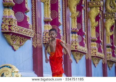 Luang Prabang , Laos - Aug 12 2018 : Novice Monk In Luang Prabang Laos On August 12 2018. It Is Esti
