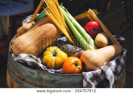 A Selection Of Healthy Winter Vegetables On Display On Top Of A Barrel