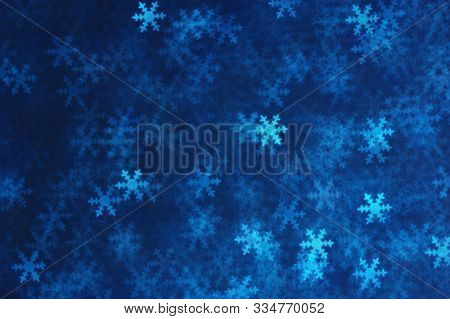 Blue snowflakes abstract lights . Blurred Bokeh. Christmas and winter background.