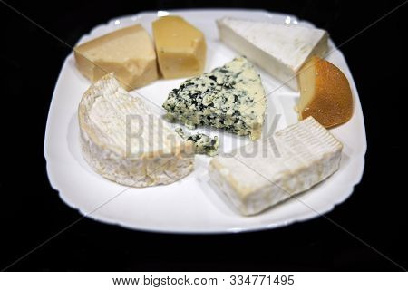 Pate With Different Kinds Of Delicious Cheese On Dark Background.camembert Brie Gorgonzola Roquefort