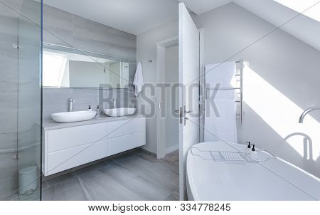 Bathroom Details Clean White Basin With Shower Tiling Behind