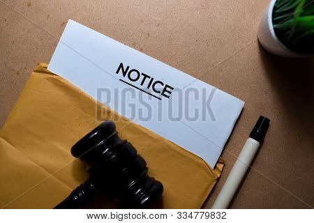 Notice In Brown Envelope And Judges Gavel. Justice And Law Concept