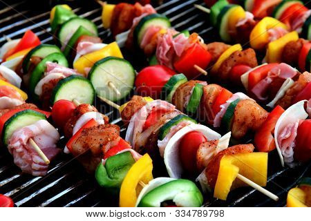 Bar-b-q Or Bbq With Kebab Cooking. Coal Grill Of Chicken Meat Skewers With Mushroom And Peppers. Bar