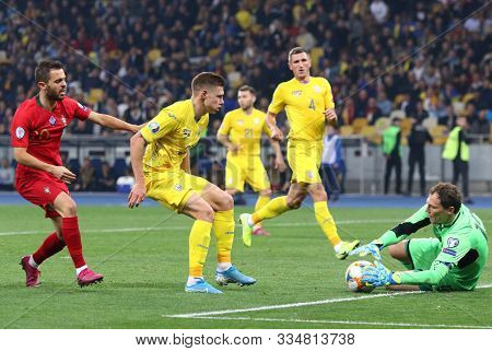 Kyiv, Ukraine - October 14, 2019: Goalkeeper Andriy Pyatov Of Ukraine (r) In Action During The Uefa