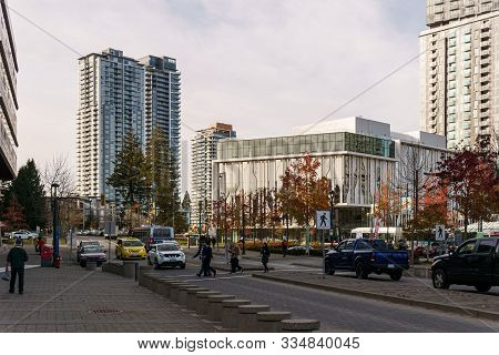 Surrey, Canada - November 6, 2019: City Center With Tall Modern Buildings And People On The Street.