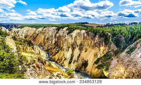 The Yellowstone River As It Flows Through The Yellow And Orange Sandstone Cliffs In The Grand Canyon