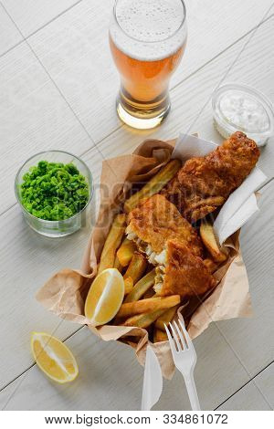 Beer, Battered Fish And Chips. Mashed Green Peas And Salad