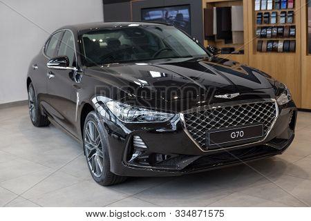 Russia, Izhevsk - October 16, 2019: New Modern Genesis G70 In The Hyundai Showroom.