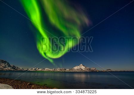 Polar Lights, Northern Lights, Aurora Borealis Over Fjord Mountains With Many Stars On The Sky In Th